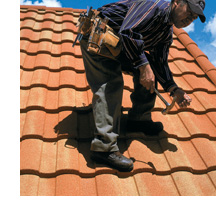 Man on Steel Tile Roof